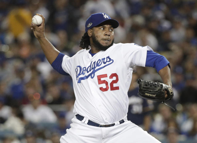 FILE - In this Tuesday, Oct. 16, 2018 file photo, Los Angeles Dodgers relief pitcher Pedro Baez throws during the sixth inning of Game 4 of the National League Championship Series baseball game against the Milwaukee Brewers in Los Angeles. Dodgers reliever Pedro Bez asked an arbitration panel for a raise to $4 million and Los Angeles argued during a hearing on Tuesday, Feb. 11, 2020 that he should be paid $3.5 million. (AP Photo/Jae Hong, File)