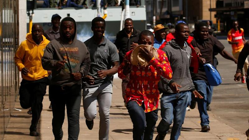 Zimbabwe police break up protesters defying court ban
