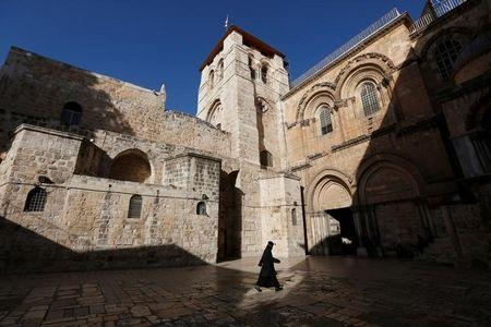 An Ethiopian monk walks at the Church of the Holy Sepulchre in Jerusalem's Old City December 27, 2013. REUTERS/Baz Ratner/Files