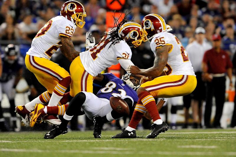 Strong safety Brandon Meriweather #31 of the Washington Redskins defends wide receiver Torrey Smith #82 of the Baltimore Ravens during a preseason game at M&T Bank Stadium on August 23, 2014 in Baltimore, Maryland