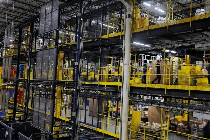 Amazon workers perform their jobs inside of an Amazon fulfillment center on Cyber Monday in Robbinsville, New Jersey