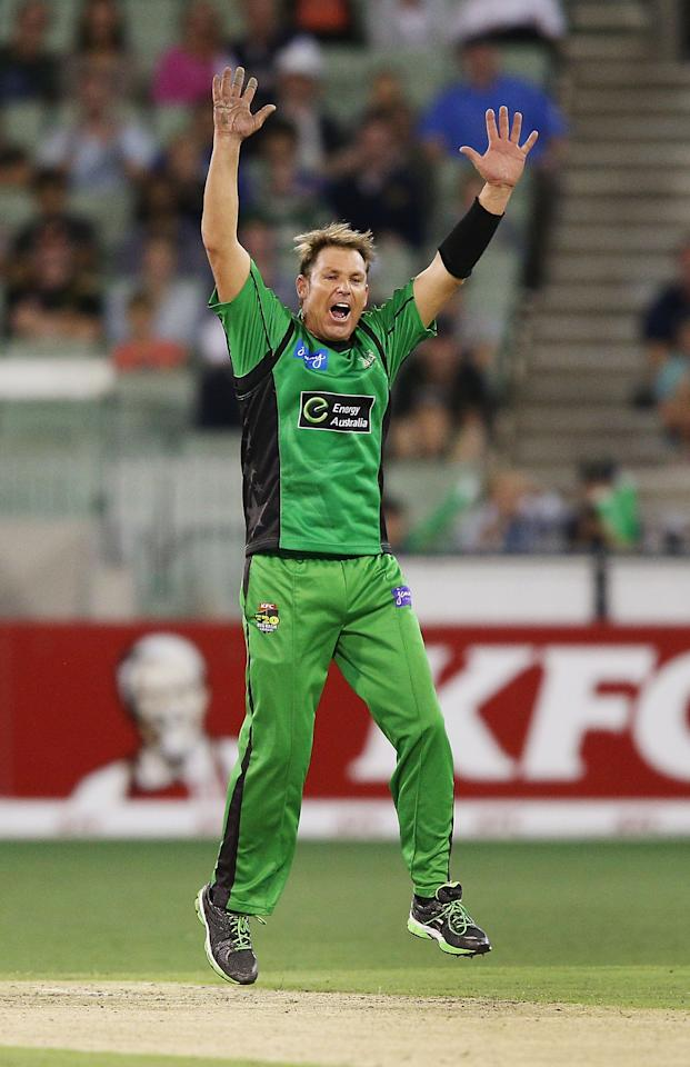 MELBOURNE, AUSTRALIA - JANUARY 06:  Shane Warne of the Melbourne Stars celebrate his wicket of Alex Doolan during the Big Bash League match between the Melbourne Stars and the Melbourne Renegades at Melbourne Cricket Ground on January 6, 2013 in Melbourne, Australia.  (Photo by Michael Dodge/Getty Images)