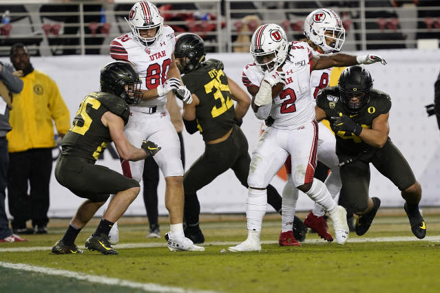 Utah running back Zack Moss (2) breaks a tackle for a touchdown run against Oregon during the second half of the Pac-12 Conference championship NCAA college football game in Santa Clara, Calif., Friday, Dec. 6, 2018. (AP Photo/Tony Avelar)