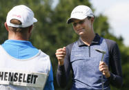 Esther Henseleit, right, of Germany, fist bumps her caddie Chris Murphy, left, after making a birdie on the 12th hole during the final round of the LPGA Volunteers of America Classic golf tournament in The Colony, Texas, Sunday, July 4, 2021. (AP Photo/Ray Carlin)