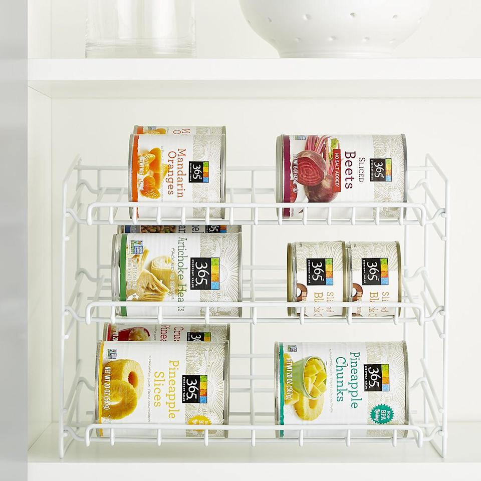 """<p><strong>Container Store</strong></p><p>containerstore.com</p><p><strong>$15.99</strong></p><p><a href=""""https://go.redirectingat.com?id=74968X1596630&url=https%3A%2F%2Fwww.containerstore.com%2Fs%2Fkitchen%2Fpantry-organizers%2Fpantry-storage%2Fwhite-gravity-feed-can-rack%2F123d%3FproductId%3D11007993&sref=https%3A%2F%2Fwww.goodhousekeeping.com%2Fhome%2Fg35292976%2Ftop-kitchen-organization-tips%2F"""" rel=""""nofollow noopener"""" target=""""_blank"""" data-ylk=""""slk:BUY NOW"""" class=""""link rapid-noclick-resp"""">BUY NOW</a></p><p>Make cans more easily accessible with this gravity-feed rack, which automatically drops the next can to the front when you grab the one you need.</p>"""