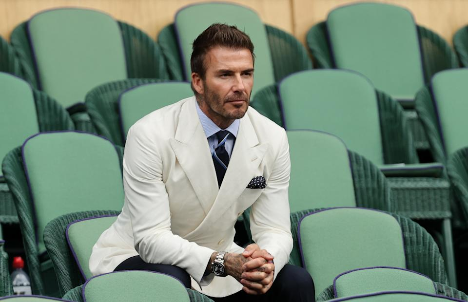 David Beckham, photographed at Wimbledon in July, jokingly pleads with his daughter Harper to