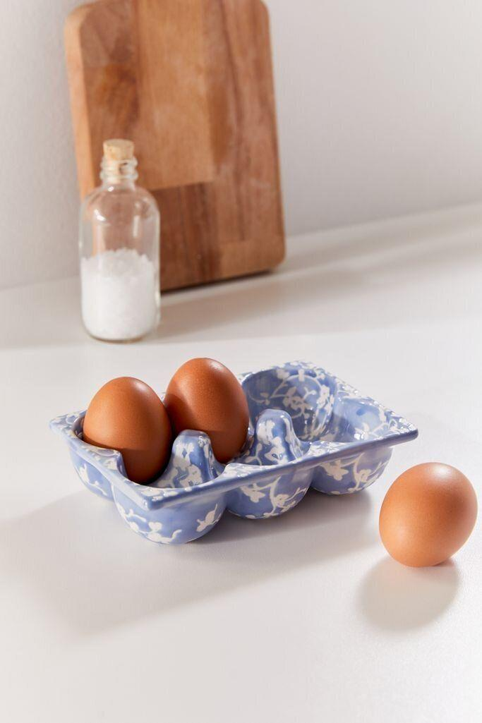 """They won't glaze over this ceramic egg tray, which can hold half a dozen eggs. That way they won't have to keep opening and closing the fridge. It has a pretty floral print, too.<a href=""""https://fave.co/3eH22kN"""" target=""""_blank"""" rel=""""noopener noreferrer"""">Find it for $16 at Urban Outfitters</a>."""