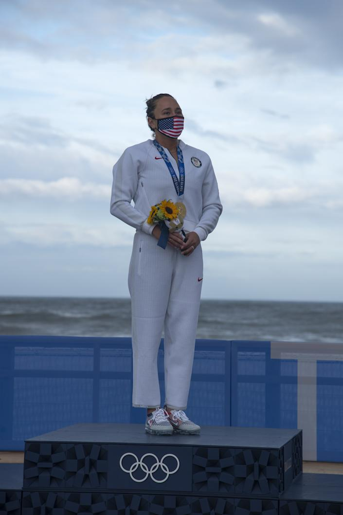<p>ICHINOMIYA, JAPAN - JULY 27: Carissa Moore of Team United States, Gold medallist celebrates on the podium on day four of the Tokyo 2020 Olympic Games at Tsurigasaki Surfing Beach on July 27, 2021 in Ichinomiya, Chiba, Japan. (Photo by Olivier Morin - Pool/Getty Images)</p>