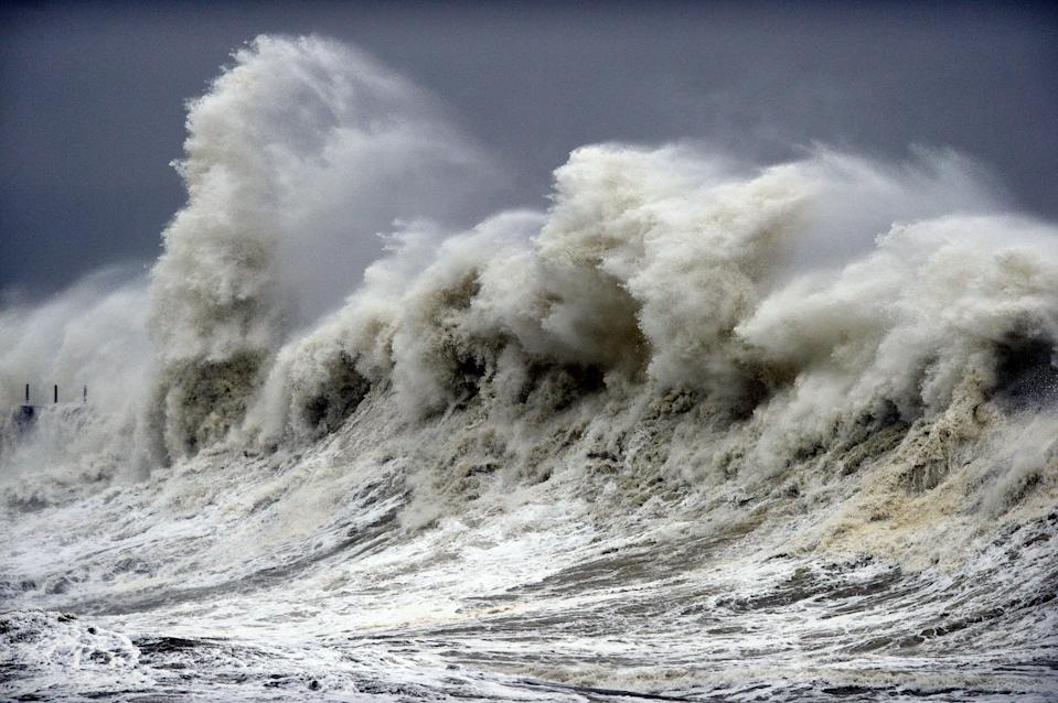 Huge waves crash against the Heugh Breakwater at the Headland in Hartlepool, County Durham. (SWNS)