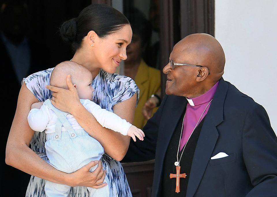 CAPE TOWN, SOUTH AFRICA - SEPTEMBER 25:  Meghan, Duchess of Sussex speaks to Archbishop Desmond Tutu while holding her baby son Archie Mountbatten-Windsor, during a visit to the Desmond & Leah Tutu Legacy Foundation during their royal tour of South Africa on September 25, 2019 in Cape Town, South Africa. (Photo by Toby Melville - Pool/Getty Images)