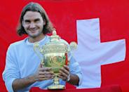 First timer: Federer poses with the Wimbledon trophy after defeating Mark Philippoussis in the 2003 final