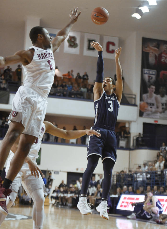 Yale's Alex Copeland (3) shoots over Harvard's Chris Lewis (0) during the first half of an NCAA college basketball game in Ivy League championship at Yale University in New Haven, Conn., Sunday, March 17, 2019, in New Haven, Conn. (AP Photo/Jessica Hill)