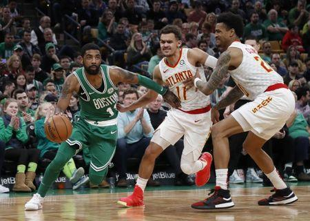Mar 16, 2019; Boston, MA, USA; Boston Celtics guard Kyrie Irving (11) drives past Atlanta Hawks guard Trae Young (11) during the second half at TD Garden. Mandatory Credit: Winslow Townson-USA TODAY Sports
