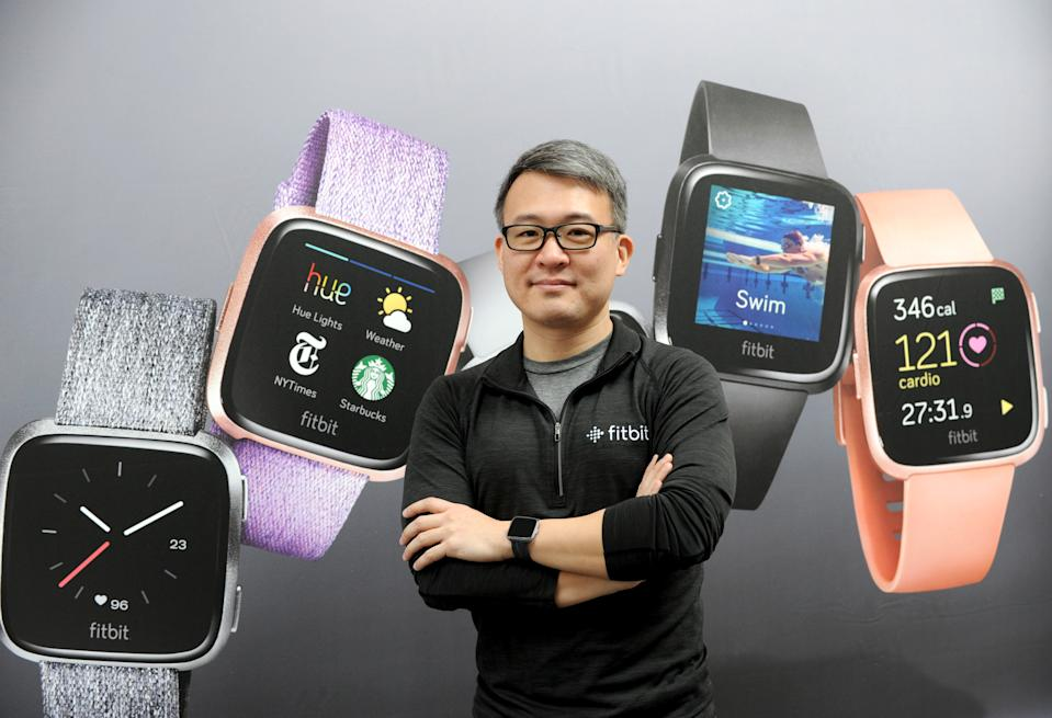 Fitbit CEO James Park unveils Fitbit's second smartwatch, Fitbit Versa, and first-ever device for kids, Fitbit Ace, along with the Fitbit family account and female health tracking at its launch event in New York, Monday, March 12, 2018. The newest devices and features from Fitbit support the company's vision of making the world healthier, while reaching more people in unique ways to continue to help them achieve their health and fitness goals. (Diane Bondareff/AP Images for Fitbit)
