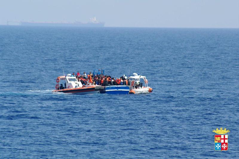 File picture released by the Italian navy on June 14, 2014 shows migrants being rescued from boats in the Mediterranean