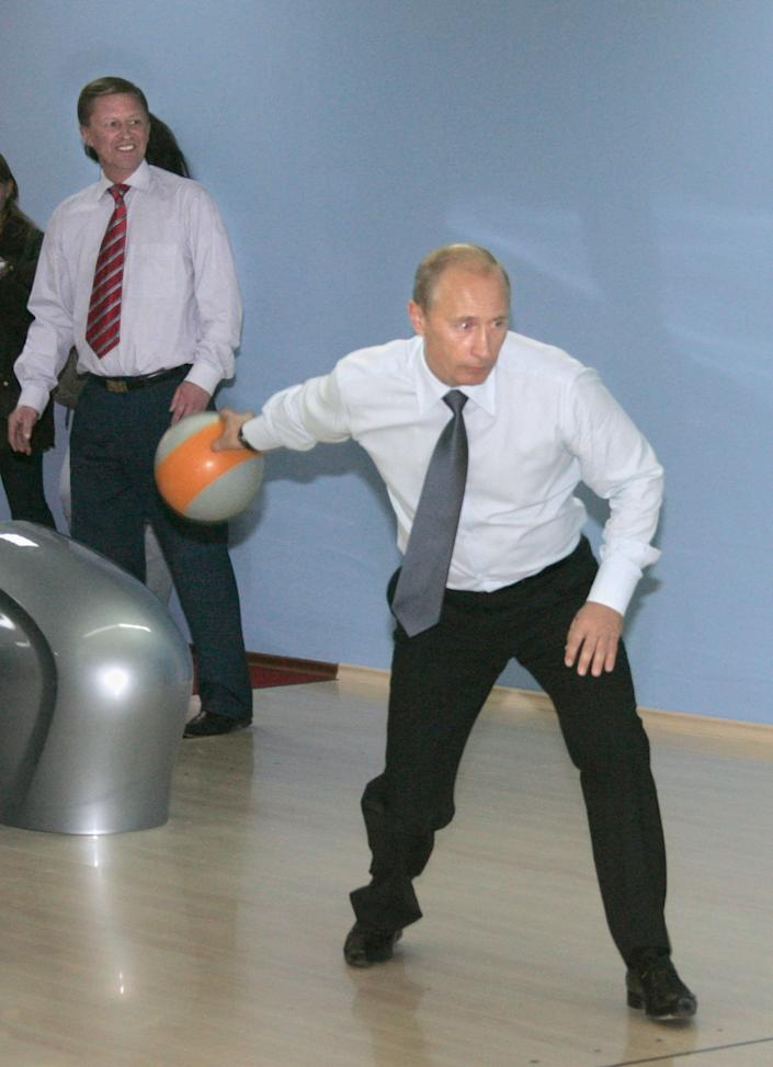 First deputy prime minister Sergei Ivanov looks on as Russian President Vladimir Putin bowls at the new sports complex ocean, Vilyuchinsk, Kamchatka in Russia, Sep. 5, 2007.
