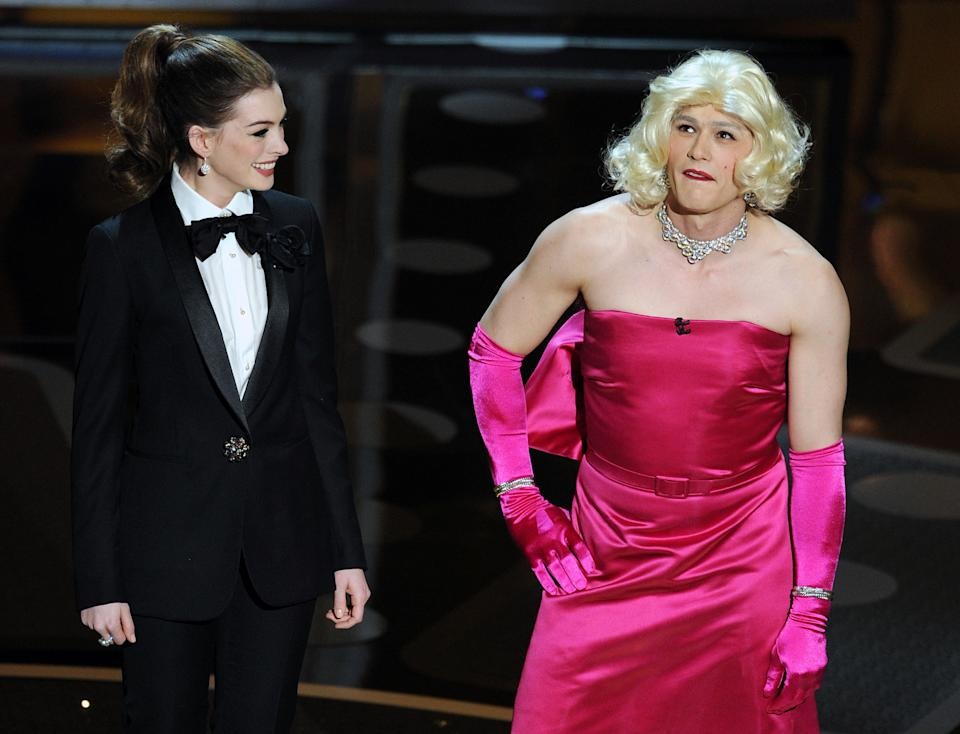Anne Hathaway and James Franco, in drag, appear on stage during the 83rd annual Academy Awards at the Kodak Theater in Hollywood on February 27, 2011. (AFP PHOTO/Gabriel BOUYS via Getty Images)