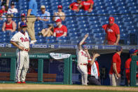 Philadelphia Phillies manager Joe Girardi, left, looks on as the safety netting snapped during the eighth inning of a baseball game against the Washington Nationals, Sunday, June 6, 2021, in Philadelphia. (AP Photo/Chris Szagola)