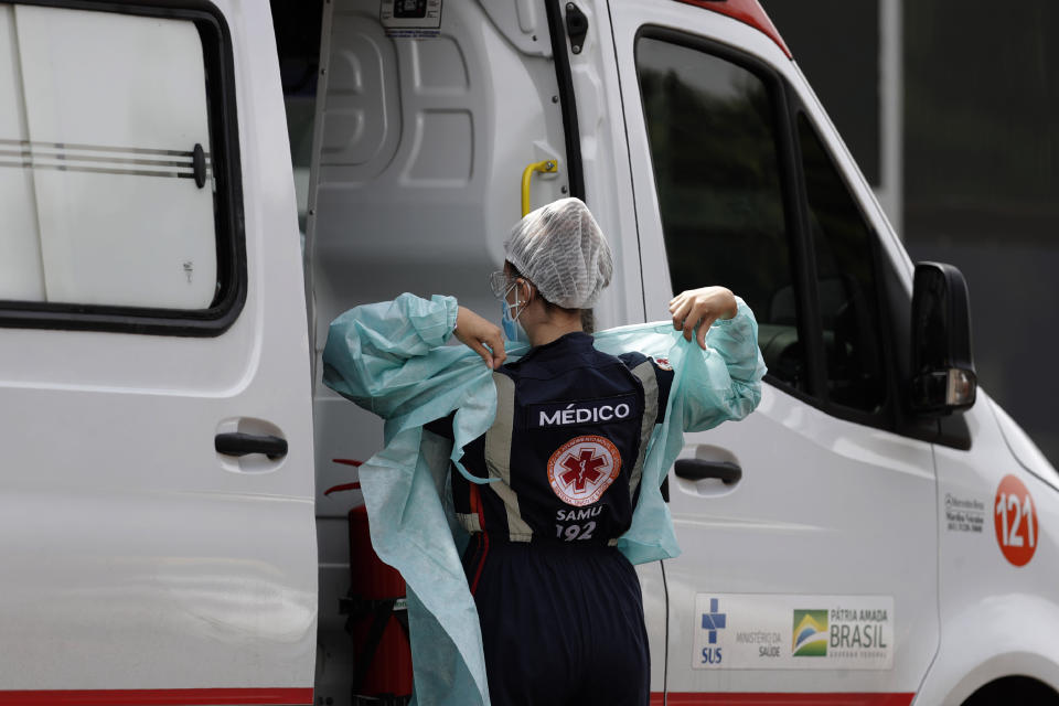 A doctor prepares to transport a patient suspected of having COVID-19 into the HRAN public hospital from an ambulance in Brasilia, Brazil, Wednesday, April 14, 2021.(AP Photo/Eraldo Peres)