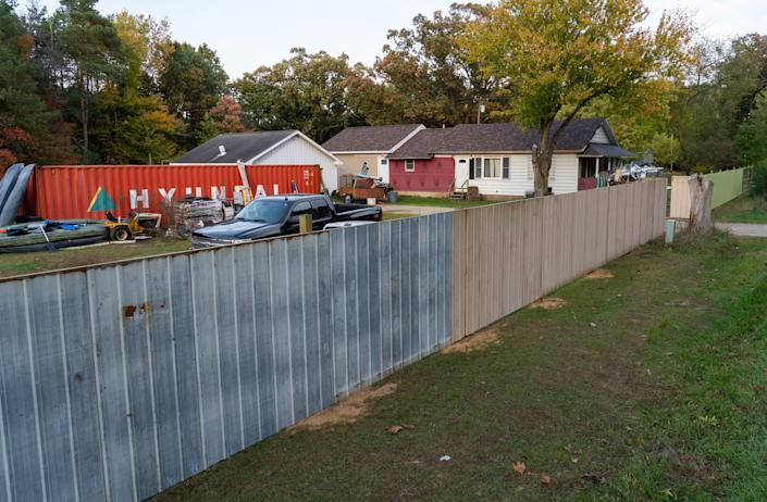 """A wall recently constructed outside of the home of William Null in Shelbyville, Mich., Oct. 9, 2020. Null is one of 13 suspects accused of plotting to abduct Michigan Gov. Gretchen Whitmer.<span class=""""copyright"""">Ryan Garza—USA Today/ NetworkSipa USA</span>"""
