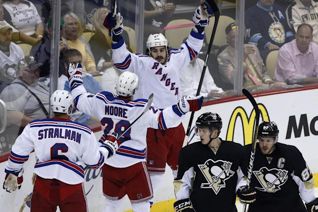 New York Rangers' Brian Boyle (22) celebrates his goal with teammates Anton Stralman (6) and Dominic Moore as Pittsburgh Penguins' Sidney Crosby (87) and Olli Maatta (3) skate back to their bench in the first period of Game 7 of a second-round NHL playoff hockey series, in Pittsburgh on Tuesday, May 13, 2014. (AP Photo)