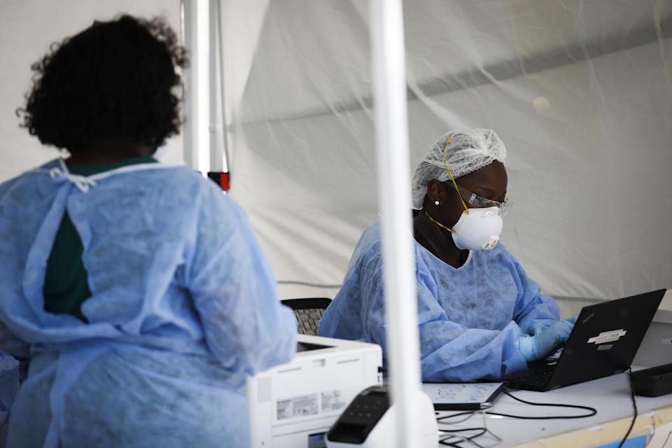 FLORIDA, USA - JULY 24: A healthcare worker collects works on a computer at a mobile COVID-19 testing facility, in Miami Beach, Florida, United States on July 24, 2020. (Photo by MARCO BELLO/Anadolu Agency via Getty Images)