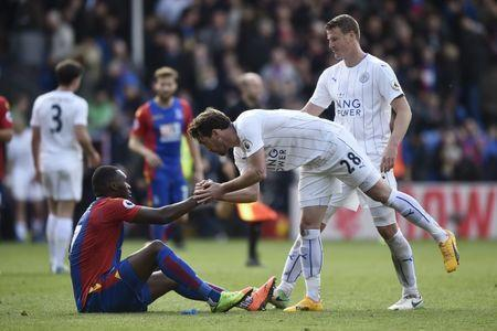 Britain Soccer Football - Crystal Palace v Leicester City - Premier League - Selhurst Park - 15/4/17 Leicester City's Christian Fuchs shakes hands with Crystal Palace's Christian Benteke after the game Reuters / Hannah McKay Livepic