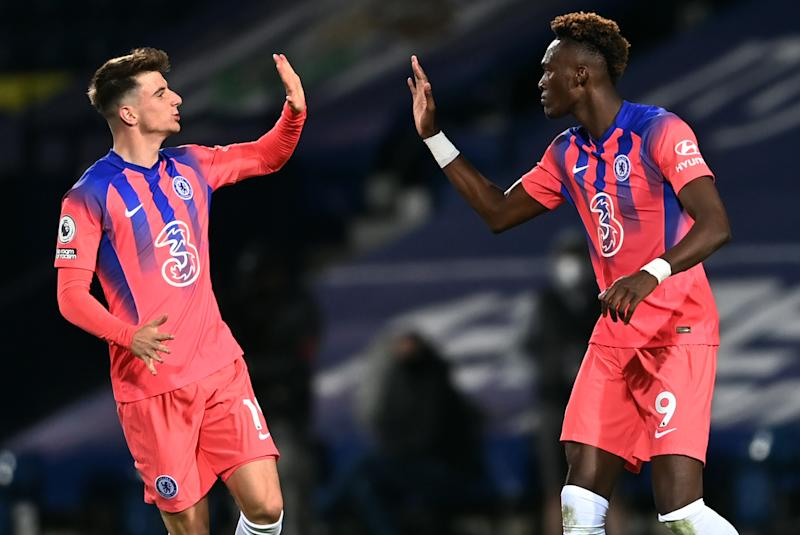 Tammy Abraham (right) celebrates with Chelsea teammate Mason Mount after scoring a stoppage-time equalizer against West Bromwich Albion. (Laurence Griffiths/Getty Images)
