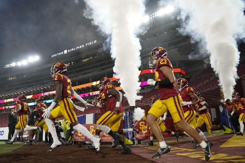 USC players enter the Coliseum before the Pac-12 title game against Oregon on Dec. 18, 2020, in Los Angeles.