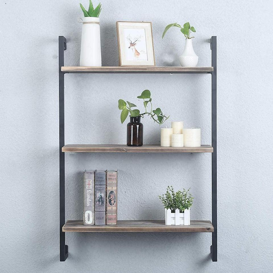 <p>The clean make of this <span>GWH Industrial Metal and Wood Wall Shelf Unit</span> ($90) keeps it from looking cluttered.</p>