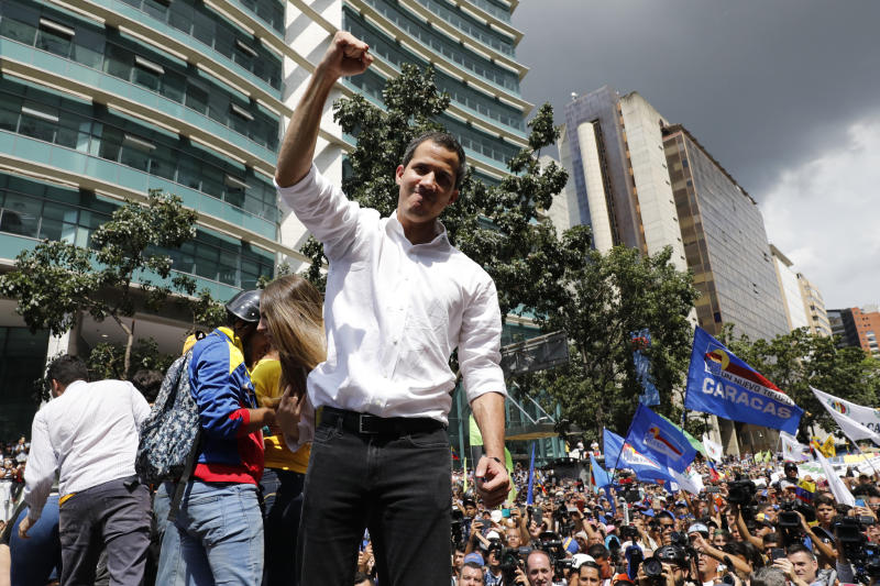Opposition politician Juan Guaido raises his right fist as he greets supporters at a rally, in Caracas, Venezuela, Saturday, Nov. 16, 2019.  Guaido called nationwide demonstrations to re-ignite a campaign against President Nicolas Maduro launched in January that has lost steam in recent months. (AP Photo/Ariana Cubillos)