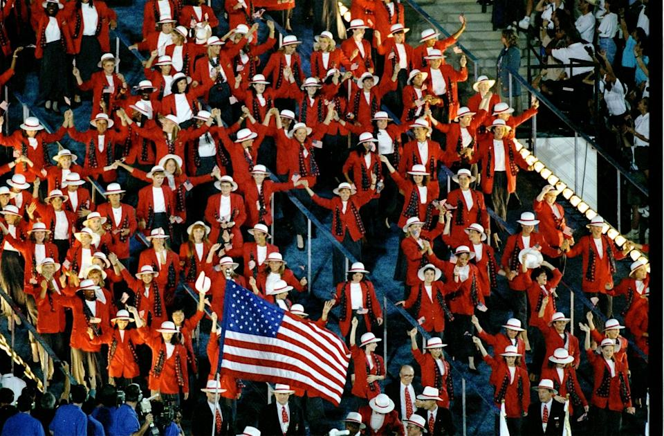 <p>At the Atlanta 1996 Olympic Games, athletes wore red jackets over simple, white tops, and switched out their cowboy hats for white sun hats with red ribbon. </p>