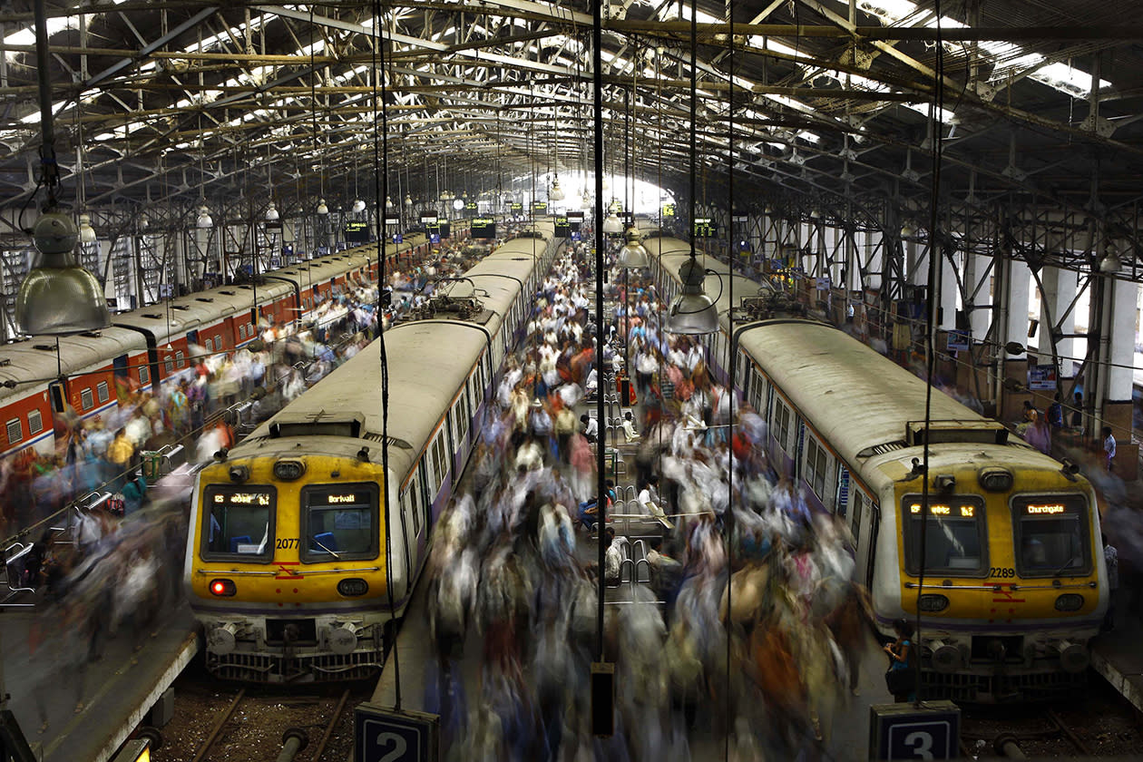 Commuters get off trains at the Church Gate railway station in Mumbai, India.