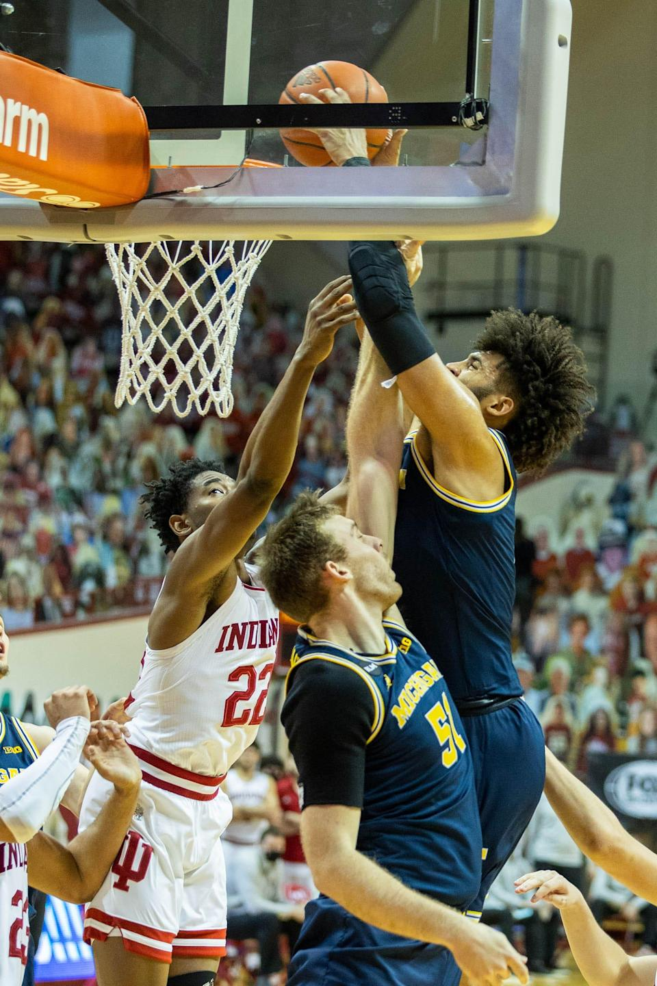 Isaiah Livers dunks over Indiana's Jordan Geronimo in the second half.
