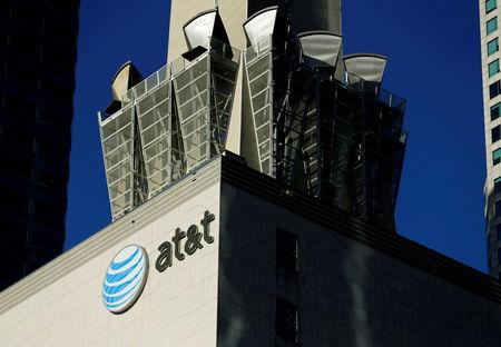 FILE PHOTO: An AT&T logo and communication equipment is shown on a building in Los Angeles