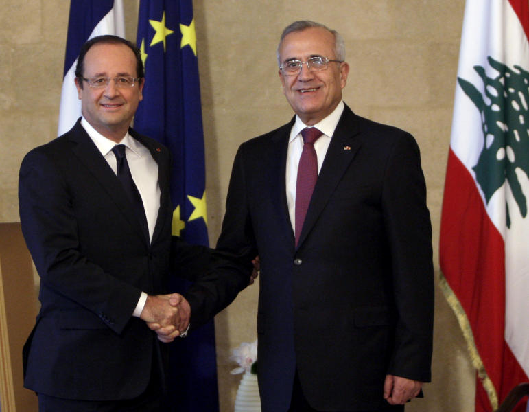 "Lebanese President Michel Suleiman, right, shakes hands for photographers with French President Francois Hollande, left, at the Presidential Palace in Baabda, east of Beirut, Lebanon, Sunday, Nov. 4, 2012. Hollande said France will stand against instability in Lebanon. Hollande's comments during a short visit to Beirut come as many in Lebanon fear that Syria's civil war could spill over. Speaking to reporters after meeting President Michel Suleiman, Hollande said that amid Syria's civil war, ""we are committed to give you guarantees regarding security, stability and the unity of Lebanon."" A top anti-Syrian intelligence chief was killed in a car bomb in Beirut last month. The assassination stirred up deadly sectarian tensions in Lebanon, where Sunnis and Shiites are deeply divided over the Syrian civil war, raising the specter of renewed sectarian fighting. (AP Photo/Bilal Hussein)"