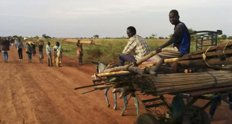 "In this image taken from video people travel on the road near Bentiu South Sudan on Sunday April 20, 2014. U.N.'s top humanitarian official in south Sudan Toby Lanzer told The Associated Press in a phone interview Tuesday April 23, 2014, that the ethnically targeted killings are ""quite possibly a game-changer"" for a conflict that has been raging since mid-December and that has exposed longstanding ethnic hostilities. There was also a disturbing echo of Rwanda, which is marking the 20th anniversary this month of its genocide that killed 1 million people. ""It's the first time we're aware of that a local radio station was broadcasting hate messages encouraging people to engage in atrocities,"" said Lanzer, who was in Bentiu on Sunday and Monday. ""And that really accelerates South Sudan's descent into an even more difficult situation from which it needs to extract itself."" (AP Photo/Toby Lanzer, United Nations)"