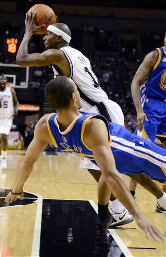 San Antonio Spurs guard T.J. Ford drives as Golden State Warriors guard Stephen Curry falls during the first half of an NBA basketball game in San Antonio, Wednesday, Jan. 4, 2012. (AP Photo/Bahram Mark Sobhani)