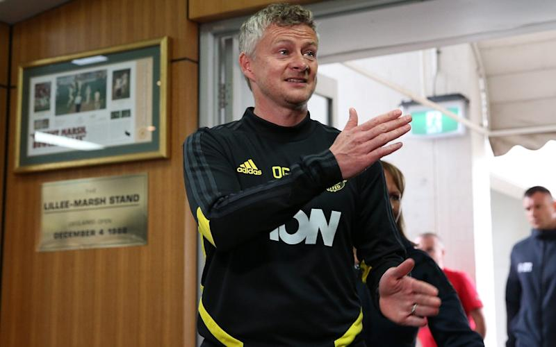 Ole Gunnar Solskjaerarrives for a media conference - Getty Images AsiaPac