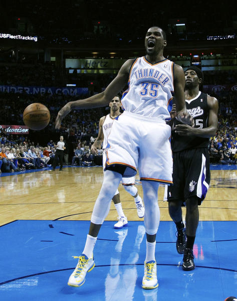 Oklahoma City Thunder forward Kevin Durant (35) reacts following a dunk in front of Sacramento Kings forward John Salmons (5) in the second quarter of an NBA basketball game in Oklahoma City, Monday, April 15, 2013. (AP Photo/Sue Ogrocki)