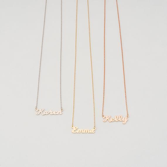 """<p><strong>TycheNYC</strong></p><p>etsy.com</p><p><strong>$26.85</strong></p><p><a href=""""https://www.etsy.com/listing/686116437/dainty-name-necklace-tiny-name-necklace"""" rel=""""nofollow noopener"""" target=""""_blank"""" data-ylk=""""slk:Shop Now"""" class=""""link rapid-noclick-resp"""">Shop Now</a></p><p>These budget-friendly custom pieces can say anything you like (well, up to eight characters of whatever you like). Remember to specify your preferred color and length! </p>"""