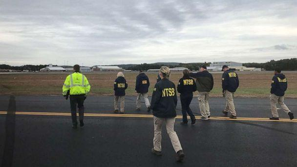 PHOTO: In this photo posted to the NTSB Newsroom Twitter account, NTSB investigators examine ground scars made by a B-17 that crashed at Bradley International Airport in Connecticut, Oct. 2, 2019. (Courtesy NTSB)