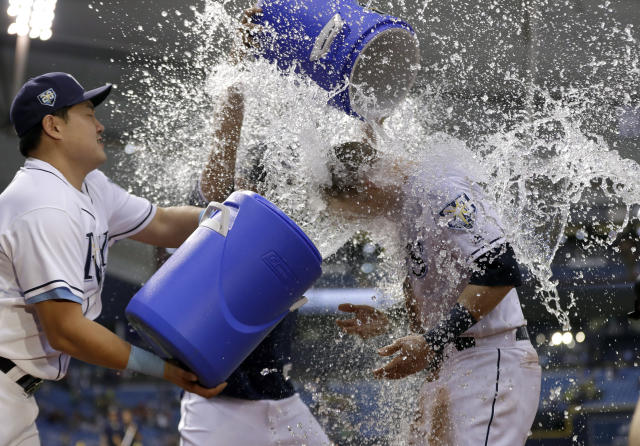 Tampa Bay Rays' Jake Bauers, right, gets doused with water by Tampa Bay Rays' Ji-Man Choi, of South Korea, left, and Willy Adames, center, after the Rays defeated the Oakland Athletics 7-5 during a baseball game, Saturday, Sept. 15, 2018, in St. Petersburg, Fla. (AP Photo/Chris O'Meara)