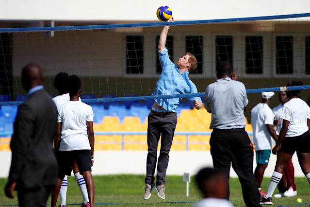Prince Harry hits the ball as he plays volleyball with children in an exhibition match during his official visit in St. Johns, Antigua November 21, 2016. REUTERS/Carlo Allegri
