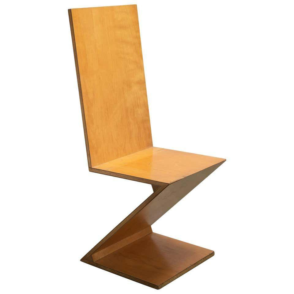 """<p><strong>Gerrit Rietveld</strong></p><p>1stdibs.com</p><p><a href=""""https://go.redirectingat.com?id=74968X1596630&url=https%3A%2F%2Fwww.1stdibs.com%2Ffurniture%2Fseating%2Fchairs%2Fzig-zag-chair-designed-gerrit-rietveld-elm-circa-1960-netherlands-europe%2Fid-f_13244691%2F&sref=https%3A%2F%2Fwww.housebeautiful.com%2Fdesign-inspiration%2Fg30750815%2Fchair-types-styles-designs%2F"""" rel=""""nofollow noopener"""" target=""""_blank"""" data-ylk=""""slk:Shop Now"""" class=""""link rapid-noclick-resp"""">Shop Now</a></p><p>""""It is not a chair but a designer's joke"""" is how Dutch designer Gerrit Rietveld described his Zig Zag chair, created in 1934 for a Dutch Department store in search of a design that could be easily mass-produced. Rietveld's creating is stunningly simple, comprised of just four pieces of wood for a striking silhouette. The chair is now produced by <a href=""""https://www.cassina.com/en/collection/chairs/280-zig-zag"""" rel=""""nofollow noopener"""" target=""""_blank"""" data-ylk=""""slk:Cassina."""" class=""""link rapid-noclick-resp"""">Cassina.</a></p>"""
