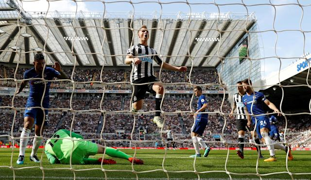 "Soccer Football - Premier League - Newcastle United vs Chelsea - St James' Park, Newcastle, Britain - May 13, 2018 Chelsea's Thibaut Courtois collects the ball from Newcastle United's Matt Ritchie Action Images via Reuters/Lee Smith EDITORIAL USE ONLY. No use with unauthorized audio, video, data, fixture lists, club/league logos or ""live"" services. Online in-match use limited to 75 images, no video emulation. No use in betting, games or single club/league/player publications. Please contact your account representative for further details. TPX IMAGES OF THE DAY"