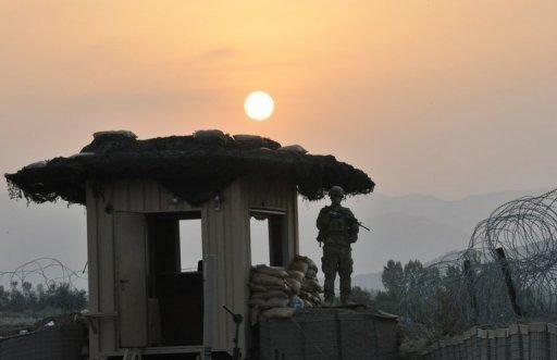 A US soldier stands on a watchtower in Khost province, eastern Afghanistan in 2011. A Taliban suicide bomber on a motorbike rammed an Afghan-NATO patrol in the town of Khost on Wednesday, killing 21 people, including three US soldiers, officials said