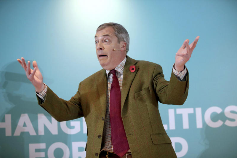 Brexit Party leader Nigel Farage gestures as he delivers a speech to supporters, during an event at the Washington Central Hotel, in Workington, England, Wednesday, Nov. 6, 2019. Britain goes to the polls on Dec. 12. (Danny Lawson/PA via AP)