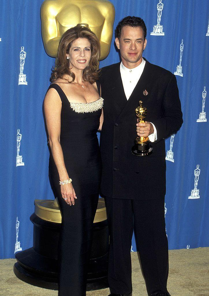 """<p>When Tom won back-to-back Oscars (only the second actor in history to do so), he gave all the credit to his relationship with Rita: """"I view my wife as my lover, and we have a bond that goes beyond words like wife or girlfriend or mother ... Without my connection with Rita, I don't know how I would've been able to connect with what Forrest was going through,"""" he <a href=""""http://www.oprah.com/omagazine/oprah-interviews-tom-hanks"""" rel=""""nofollow noopener"""" target=""""_blank"""" data-ylk=""""slk:told Oprah"""" class=""""link rapid-noclick-resp"""">told Oprah</a>, adding that was why he thanked her in his acceptance speech for <em><a href=""""https://www.amazon.com/Forrest-Gump-Tom-Hanks/dp/B002QVZ71I/?tag=syn-yahoo-20&ascsubtag=%5Bartid%7C10055.g.3131%5Bsrc%7Cyahoo-us"""" rel=""""nofollow noopener"""" target=""""_blank"""" data-ylk=""""slk:Forrest Gump"""" class=""""link rapid-noclick-resp"""">Forrest Gump</a>.</em> </p><p>""""I said that I have a woman who teaches me what love is every day,"""" he continued. """"Maybe that sentiment is possible to fake, but for me it's really true. What makes me different from others is that I verbalize this stuff. A lot of people would flee from what they think is award-show cheesiness, and I don't. I often joke that my speeches are very personal moments that play themselves out in front of billions of people."""" </p><p>That year, the couple also welcomed son Truman Theodore.</p>"""