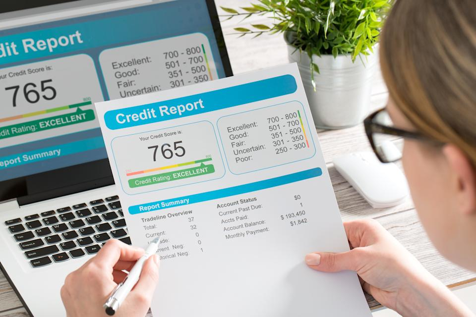 Checking your credit report for errors is a key component of financial health. (Photo: Getty)
